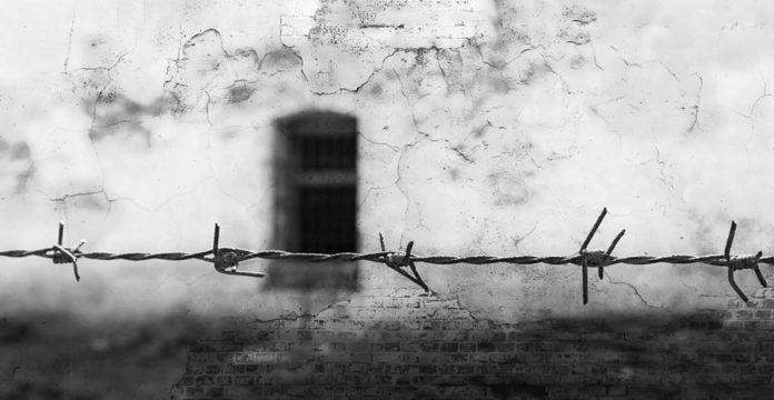 zid,închisoare,sârmă ghimpată